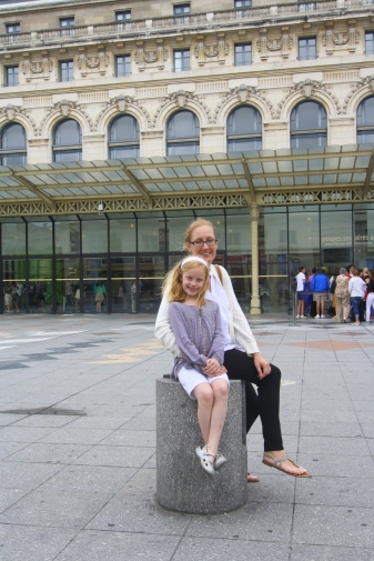 Sitting in front of the Musee d Orsay