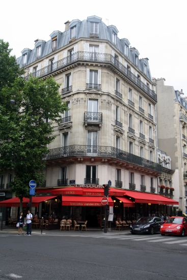 Typical Boulevard typical building in Paris.  Cafe on ground floor, ornate 2nd 5th floors.