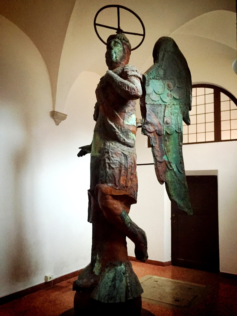 This is the original angel that sat atop the bell tower of the church.  It is wood with bronze cladding.